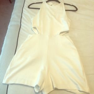 Express white romper with side cut-outs & pockets